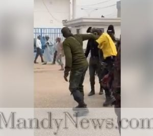 Armed Policemen Brutally Beat Road Safety Official Publicly In Kano (Photos)