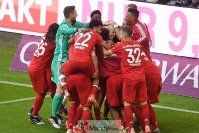 Bayern Munich's team members celebrate after the goal of Bayern Munich's Dutch midfielder Arjen Robben during the German First division Bundesliga football match FC Bayern Munich v Eintracht Frankfurt in Munich, southern Germany, on May 18, 2019. (Photo credit should read CHRISTOF STACHE/AFP/Getty Images)